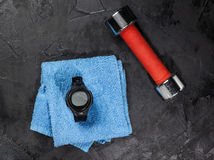 Heart rate monitor on blue towel near soccer ball Stock Photo