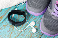 Heart rate monitor with running shoes Royalty Free Stock Images