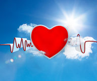 Heart rate waveform with big red heart. On blue sky background Royalty Free Stock Images