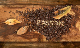 A heart of  raw and toasted coffee beans with dry leaves of magnolia. Stock Photo