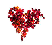 Heart of red amber. Heart from the pieces of red amber on a white background Royalty Free Stock Photo