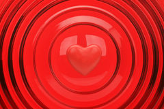 Heart on a red background. With concentric circles Royalty Free Stock Photos