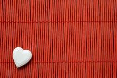 Heart on red bamboo bottom corner left Stock Photography