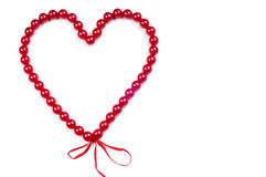 Heart from red beads Stock Photo