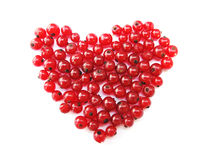 Heart of red berries. Gooseberries (currants) in the form of a red heart on a white background Royalty Free Stock Photo