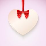 Heart with red bow hanging not tape. Greetings card, banner for your creativity Royalty Free Stock Images