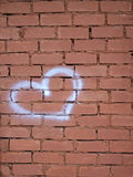 Heart on red brick wall Stock Images