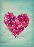 Heart from red buttons Stock Photo