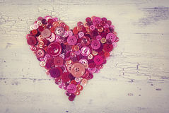 Heart from red buttons Stock Photos