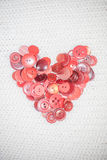 Heart of red buttons Stock Photos