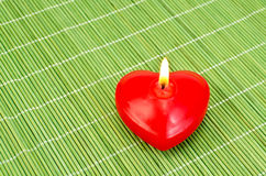 Heart of red candles on bamboo Stock Image