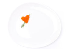 Heart of red caviar with dill on a plate, isolated Stock Images