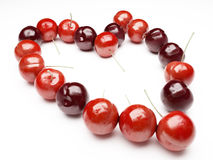 Heart from red cherry Royalty Free Stock Images