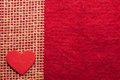 Heart on red cloth background Stock Images