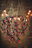 Heart of red garlands lights Stock Photography