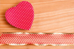 Heart and red golden ribbon Stock Photos