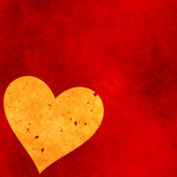 Heart on a red grunge background. Valentine's day symbol Stock Photos