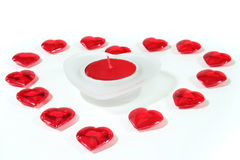 Heart of red hearts with candle as background Royalty Free Stock Photo