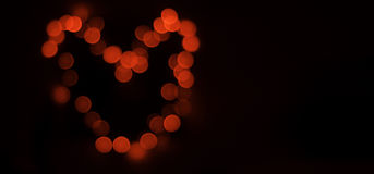 Heart. Red heart lights bokeh on dark background Royalty Free Stock Images
