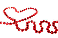 Heart from a red pearl necklace Royalty Free Stock Images