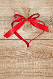 Heart from red ribbon Royalty Free Stock Images