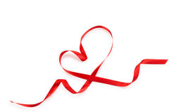 Heart from red ribbon. Royalty Free Stock Images