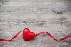 Heart with red ribbon  Royalty Free Stock Images