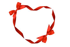 Heart from red ribbons and bows Royalty Free Stock Image