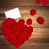 Heart of Red Rose Petals. On the wooden background Stock Photography
