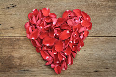 Heart of red rose petals on wooden. Valentine's Day, anniversary Stock Photos