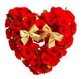 Heart of red roses with golden bow Stock Images