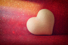 Heart on red shiny background Stock Images