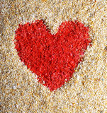 Red heart sign in yellow sand Royalty Free Stock Photo