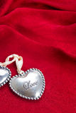 Heart on red silk  background Stock Photos