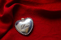 Heart on red silk  background Stock Photo