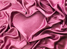 Heart from red silk drape, background with copy space Stock Photo