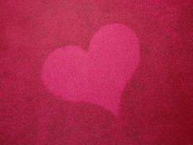 Heart on red silk Royalty Free Stock Image