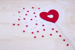 Heart and red stars on a wooden surface Royalty Free Stock Photo