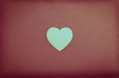 Heart on red vintage leather background Royalty Free Stock Image