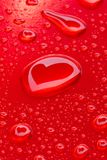Heart reflected in drops Stock Image