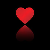 Heart reflection. Big red dappled heart with reflection on black background Stock Photos