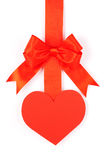Heart on a ribbon with a bow. On a white background Stock Photos
