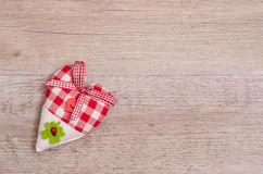 Heart with ribbon of bow Stock Images