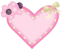 Heart with ribbon and flowers Stock Photos