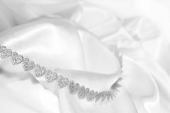Heart ribbon on silk Stock Image