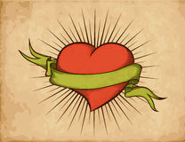 Heart with ribbon in tattoo style on old paper. Woodcut Stock Photo