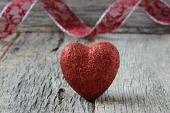 Heart with Ribbon on Vintage Wood Background stock photo