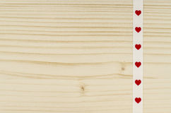 Heart ribbon on wooden background Royalty Free Stock Photo