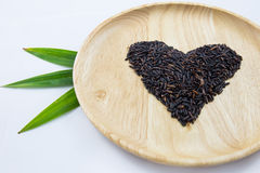 Heart rice berry in wooden bowls and green pandan Stock Photography