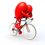 Heart riding a bicycle Stock Photo